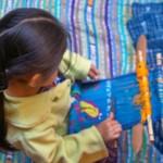 A Guatemala child weaving